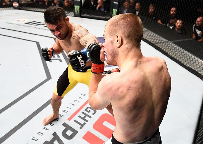 SIOUX FALLS, SD - JULY 13:   (L-R) John Lineker punches Michael McDonald in their bantamweight bout during the UFC Fight Night event on July 13, 2016 at Denny Sanford Premier Center in Sioux Falls, South Dakota. (Photo by Jeff Bottari/Zuffa LLC/Zuffa LLC