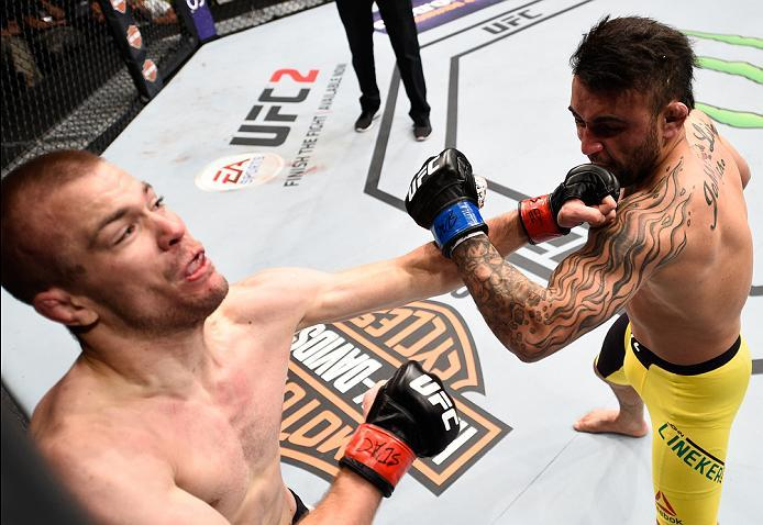 SIOUX FALLS, SD - JULY 13:   (R-L) John Lineker punches Michael McDonald in their bantamweight bout during the UFC Fight Night event on July 13, 2016 at Denny Sanford Premier Center in Sioux Falls, South Dakota. (Photo by Jeff Bottari/Zuffa LLC/Zuffa LLC