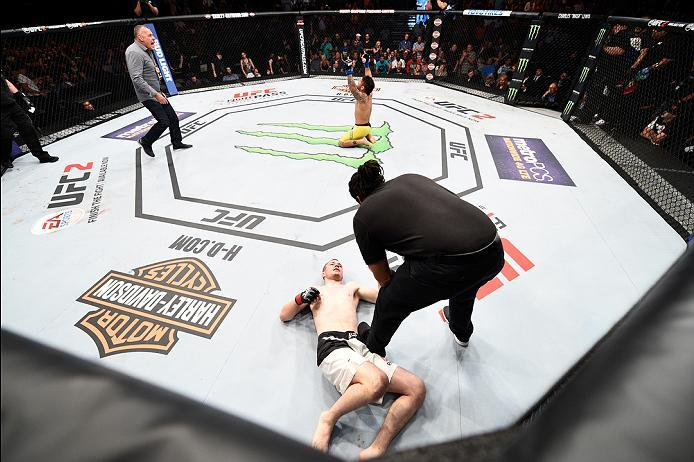 SIOUX FALLS, SD - JULY 13:   John Lineker celebrates his knockout victory over Michael McDonald in their bantamweight bout during the UFC Fight Night event on July 13, 2016 at Denny Sanford Premier Center in Sioux Falls, South Dakota. (Photo by Jeff Botta