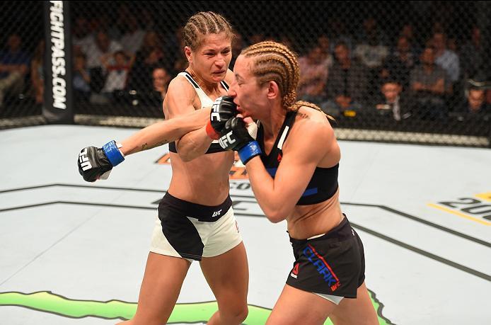 ROTTERDAM, NETHERLANDS - MAY 08:  (L-R) Karolina Kowalkiewicz punches Heather Jo Clark in their women's strawweight bout during the UFC Fight Night event at Ahoy Rotterdam on May 8, 2016 in Rotterdam, Netherlands. (Photo by Josh Hedges/Zuffa LLC/Zuffa LLC