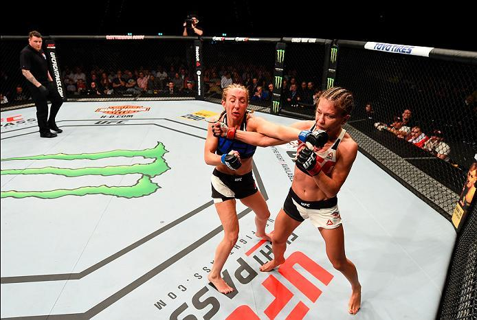 ROTTERDAM, NETHERLANDS - MAY 08:  (L-R) Heather Jo Clark exchanges punches with Karolina Kowalkiewicz in their women's strawweight bout during the UFC Fight Night event at Ahoy Rotterdam on May 8, 2016 in Rotterdam, Netherlands. (Photo by Josh Hedges/Zuff