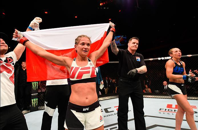 ROTTERDAM, NETHERLANDS - MAY 08:  (L-R) Karolina Kowalkiewicz celebrates her victory over Heather Jo Clark in their women's strawweight bout during the UFC Fight Night event at Ahoy Rotterdam on May 8, 2016 in Rotterdam, Netherlands. (Photo by Josh Hedges