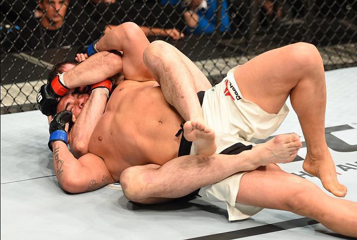 ROTTERDAM, NETHERLANDS - MAY 08:  (R-L) Nikita Krylov submits Francimar Barroso in their light heavyweight bout during the UFC Fight Night event at Ahoy Rotterdam on May 8, 2016 in Rotterdam, Netherlands. (Photo by Josh Hedges/Zuffa LLC/Zuffa LLC via Gett