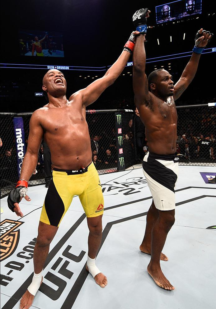 BROOKLYN, NEW YORK - FEBRUARY 11:  (L-R) Anderson Silva of Brazil and Derek Brunson raise their hands after their middleweight bout during the UFC 208 event inside Barclays Center on February 11, 2017 in Brooklyn, New York. (Photo by Jeff Bottari/Zuffa LL