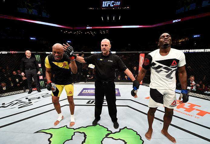 BROOKLYN, NEW YORK - FEBRUARY 11:  (L-R) Anderson Silva of Brazil celebrates his victory over Derek Brunson in their middleweight bout during the UFC 208 event inside Barclays Center on February 11, 2017 in Brooklyn, New York. (Photo by Jeff Bottari/Zuffa