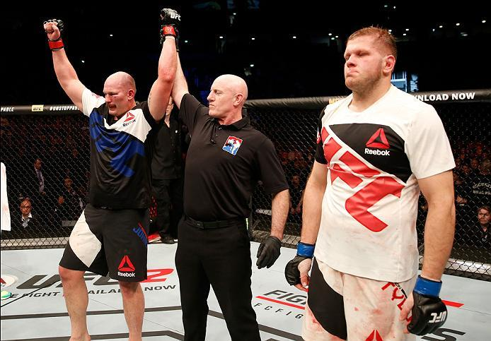 ZAGREB, CROATIA - APRIL 10:   (L-R) Timothy Johnson celebrates his victory over Marcin Tybura in their heavyweight bout during the UFC Fight Night event at the Arena Zagreb on April 10, 2016 in Zagreb, Croatia. (Photo by Srdjan Stevanovic/Zuffa LLC/Zuffa