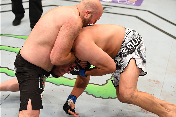 NEW ORLEANS, LA - JUNE 06:   (L-R) Ben Rothwell submits Matt Mitrione in their heavyweight bout during the UFC event at the Smoothie King Center on June 6, 2015 in New Orleans, Louisiana. (Photo by Josh Hedges/Zuffa LLC/Zuffa LLC via Getty Images)