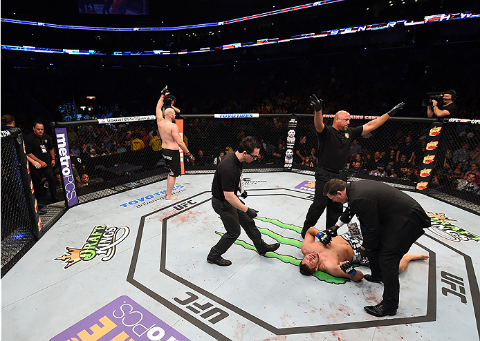 NEW ORLEANS, LA - JUNE 06:   (L-R) Ben Rothwell celebrates his submission victory over Matt Mitrione in their heavyweight bout during the UFC event at the Smoothie King Center on June 6, 2015 in New Orleans, Louisiana. (Photo by Josh Hedges/Zuffa LLC/Zuff