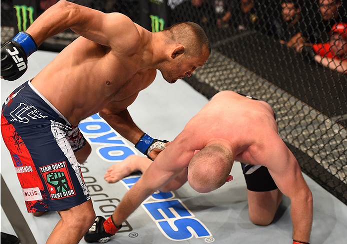 NEW ORLEANS, LA - JUNE 06:   (L-R) Dan Henderson punches Tim Boetsch in their middleweight bout during the UFC event at the Smoothie King Center on June 6, 2015 in New Orleans, Louisiana. (Photo by Josh Hedges/Zuffa LLC/Zuffa LLC via Getty Images)