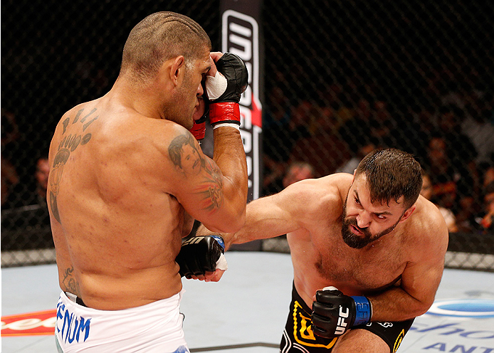 "BRASILIA, DF - SEPTEMBER 13: (R-L) Andrei Arlovski of Belarus lands an uppercut against Antonio ""Bigfoot"" Silva of Brazil in their heavyweight bout during the UFC Fight Night event inside Nilson Nelson Gymnasium on September 13, 2014 in Brasilia, Brazil."