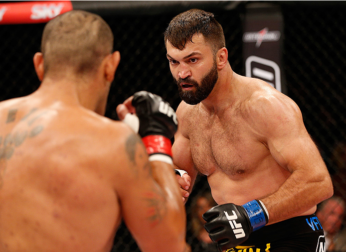 "BRASILIA, DF - SEPTEMBER 13: (R-L) Andrei Arlovski of Belarus squares off with Antonio ""Bigfoot"" Silva of Brazil in their heavyweight bout during the UFC Fight Night event inside Nilson Nelson Gymnasium on September 13, 2014 in Brasilia, Brazil. (Photo by"