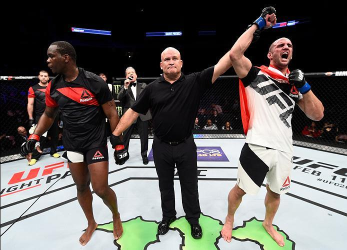 HOUSTON, TX - FEBRUARY 04:  (R-L) Volkan Oezdemir of Switzerland celebrates his victory over Ovince Saint Preux in their light heavyweight bout during the UFC Fight Night event at the Toyota Center on February 4, 2017 in Houston, Texas. (Photo by Jeff Bot