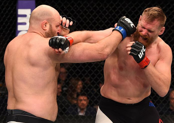 NEWARK, NJ - JANUARY 30:  (R-L) Josh Barnett  exchanges punches with Ben Rothwell in their heavyweight bout during the UFC Fight Night event at the Prudential Center on January 30, 2016 in Newark, New Jersey. (Photo by Josh Hedges/Zuffa LLC/Zuffa LLC via