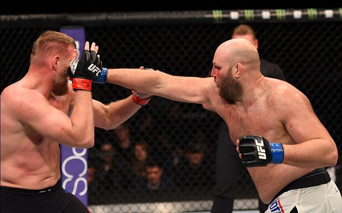 NEWARK, NJ - JANUARY 30:  (R-L) Ben Rothwell punches Josh Barnett in their heavyweight bout during the UFC Fight Night event at the Prudential Center on January 30, 2016 in Newark, New Jersey. (Photo by Josh Hedges/Zuffa LLC/Zuffa LLC via Getty Images)