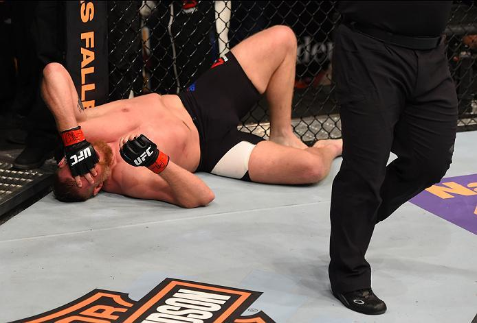 NEWARK, NJ - JANUARY 30:  Josh Barnett reacts after being submitted by Ben Rothwell in their heavyweight bout during the UFC Fight Night event at the Prudential Center on January 30, 2016 in Newark, New Jersey. (Photo by Josh Hedges/Zuffa LLC/Zuffa LLC vi