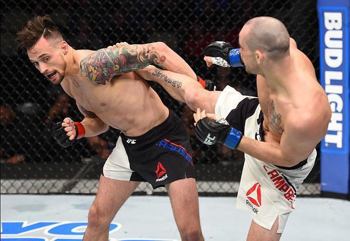 PITTSBURGH, PA - FEBRUARY 21:  (R-L) Chris Camozzi kicks Joe Riggs in their middleweight bout during the UFC Fight Night event at Consol Energy Center on February 21, 2016 in Pittsburgh, Pennsylvania. (Photo by Jeff Bottari/Zuffa LLC/Zuffa LLC via Getty I