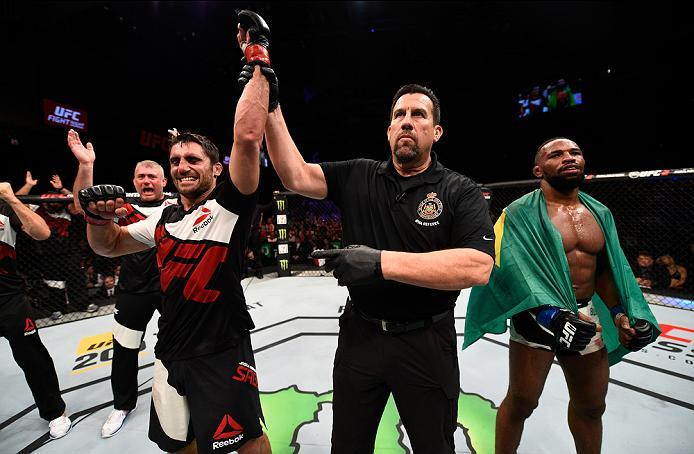 OTTAWA, ON - JUNE 18:   (L-R) Jason Saggo of Canada celebrates his victory over Leandro Silva of Brazil in their lightweight bout during the UFC Fight Night event inside the TD Place Arena on June 18, 2016 in Ottawa, Ontario, Canada. (Photo by Jeff Bottar