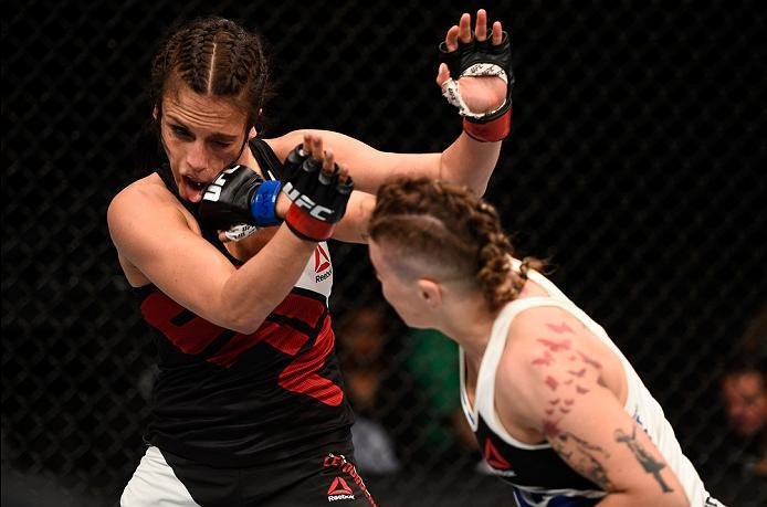 OTTAWA, ON - JUNE 18:   (R-L) Joanne Calderwood of Scotland punches Valerie Letourneau of Canada in their women's flyweight bout during the UFC Fight Night event inside the TD Place Arena on June 18, 2016 in Ottawa, Ontario, Canada. (Photo by Jeff Bottari
