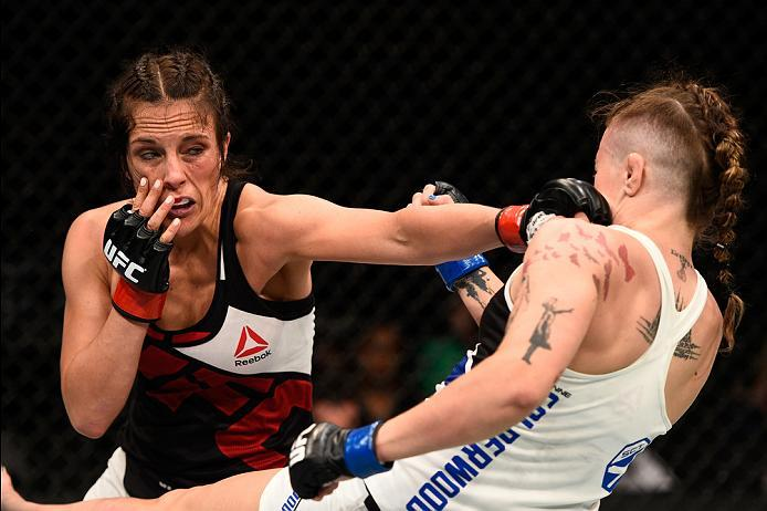 OTTAWA, ON - JUNE 18:   (L-R) Valerie Letourneau of Canada punches Joanne Calderwood of Scotland in their women's flyweight bout during the UFC Fight Night event inside the TD Place Arena on June 18, 2016 in Ottawa, Ontario, Canada. (Photo by Jeff Bottari