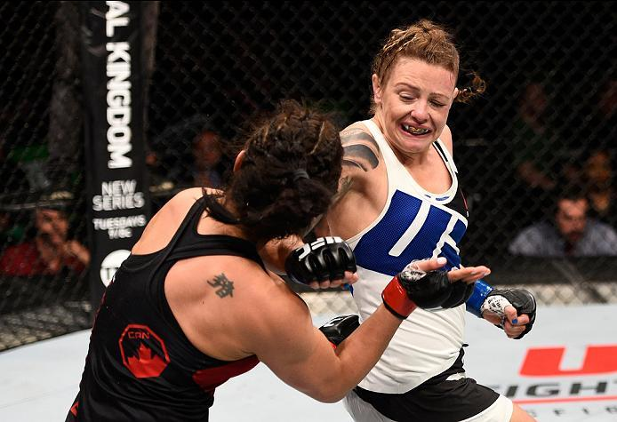OTTAWA, ON - JUNE 18:   (R-L) Joanne Calderwood of Scotland hits Valerie Letourneau of Canada with a spinning back fist in their women's flyweight bout during the UFC Fight Night event inside the TD Place Arena on June 18, 2016 in Ottawa, Ontario, Canada.