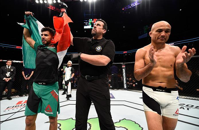 PHOENIX, AZ - JANUARY 15:  (L-R) Yair Rodriguez celebrates his victory over BJ Penn in their featherweight bout during the UFC Fight Night event inside Talking Stick Resort Arena on January 15, 2017 in Phoenix, Arizona. (Photo by Jeff Bottari/Zuffa LLC/Zu