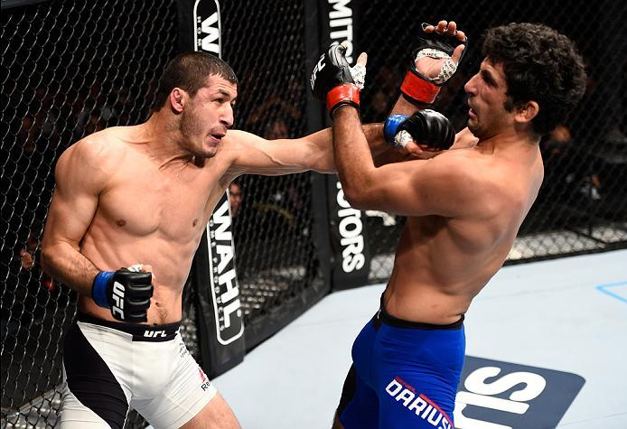 MEXICO CITY, MEXICO - NOVEMBER 05:  (L-R) Rashid Magomedov of Russia punches Beneil Dariush of Iran in their lightweight bout during the UFC Fight Night event at Arena Ciudad de Mexico on November 5, 2016 in Mexico City, Mexico. (Photo by Jeff Bottari/Zuf