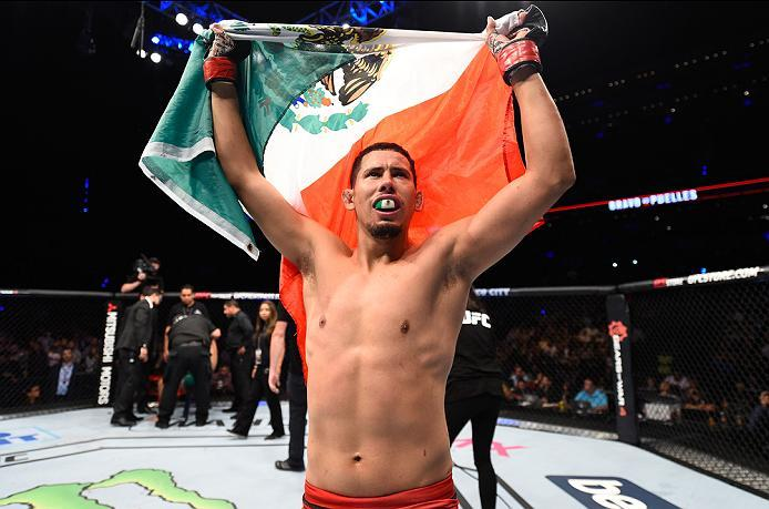 MEXICO CITY, MEXICO - NOVEMBER 05:  Martin Bravo Flores of Mexico celebrates his victory over Claudio Puelles of Peru in their lightweight bout during the UFC Fight Night event at Arena Ciudad de Mexico on November 5, 2016 in Mexico City, Mexico. (Photo b