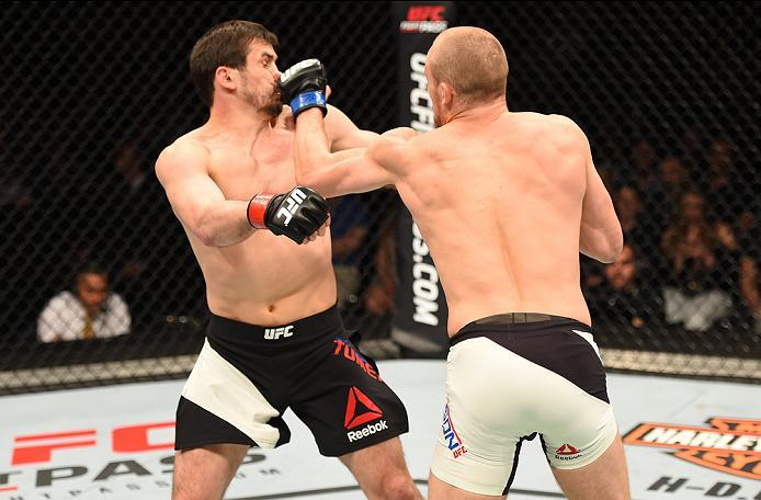 ROTTERDAM, NETHERLANDS - MAY 08:  (R-L) Gunnar Nelson punches Albert Tumenov in their welterweight bout during the UFC Fight Night event at Ahoy Rotterdam on May 8, 2016 in Rotterdam, Netherlands. (Photo by Josh Hedges/Zuffa LLC/Zuffa LLC via Getty Images