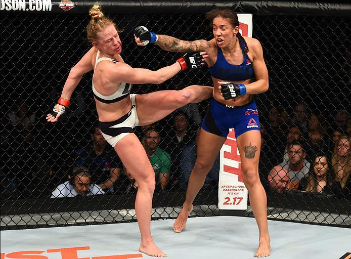 BROOKLYN, NEW YORK - FEBRUARY 11:  (R-L) Germaine de Randamie of The Netherlands punches Holly Holm in their women's featherweight championship bout during the UFC 208 event inside Barclays Center on February 11, 2017 in Brooklyn, New York. (Photo by Jeff