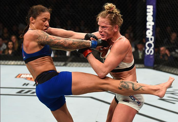BROOKLYN, NEW YORK - FEBRUARY 11:  (R-L) Holly Holm exchanges punches with Germaine de Randamie of The Netherlands in their women's featherweight championship bout during the UFC 208 event inside Barclays Center on February 11, 2017 in Brooklyn, New York.