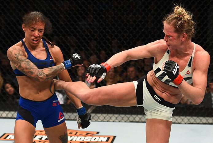 BROOKLYN, NEW YORK - FEBRUARY 11:  (R-L) Holly Holm kicks Germaine de Randamie of The Netherlands in their women's featherweight championship bout during the UFC 208 event inside Barclays Center on February 11, 2017 in Brooklyn, New York. (Photo by Jeff B