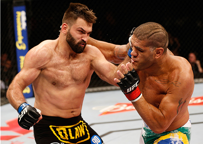 "BRASILIA, BRAZIL - SEPTEMBER 13: (R-L) Antonio ""Bigfoot"" Silva of Brazil and Andrei Arlovski of Belarus trade punches in their heavyweight bout during the UFC Fight Night event inside Nilson Nelson Gymnasium on September 13, 2014 in Brasilia, Brazil. (Pho"