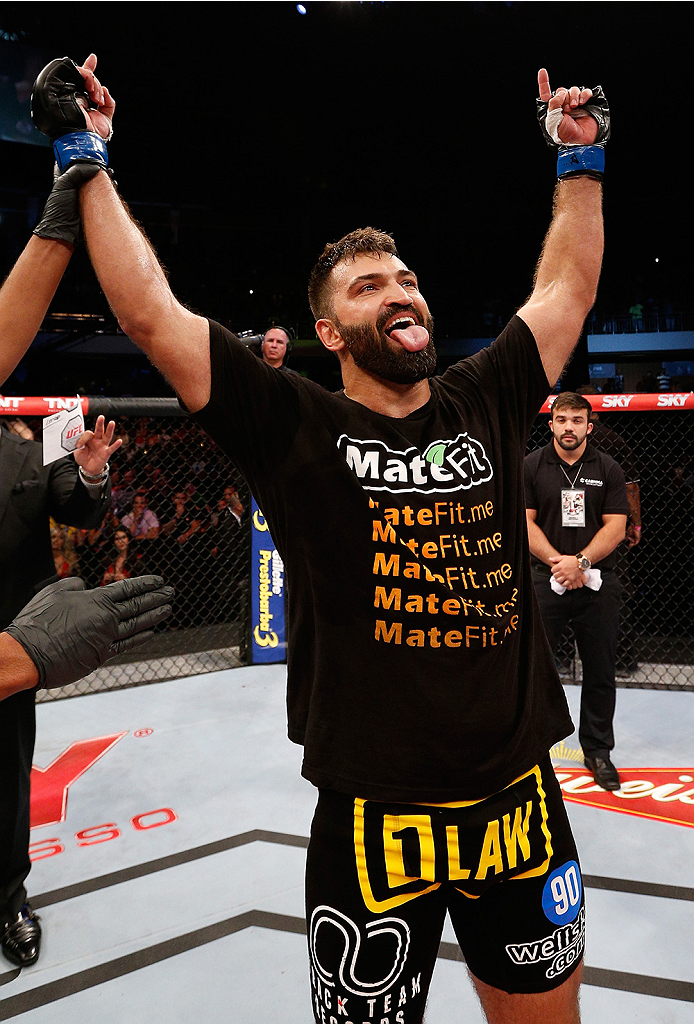 "BRASILIA, BRAZIL - SEPTEMBER 13:  Andrei Arlovski of Belarus celebrates after his knockout victory over Antonio ""Bigfoot"" Silva of Brazil in their heavyweight bout during the UFC Fight Night event inside Nilson Nelson Gymnasium on September 13, 2014 in Br"