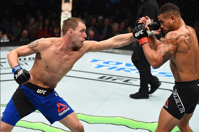 HOUSTON, TX - FEBRUARY 04:  (L-R) James Vick punches Abel Trujillo in their lightweight bout during the UFC Fight Night event at the Toyota Center on February 4, 2017 in Houston, Texas. (Photo by Jeff Bottari/Zuffa LLC/Zuffa LLC via Getty Images)