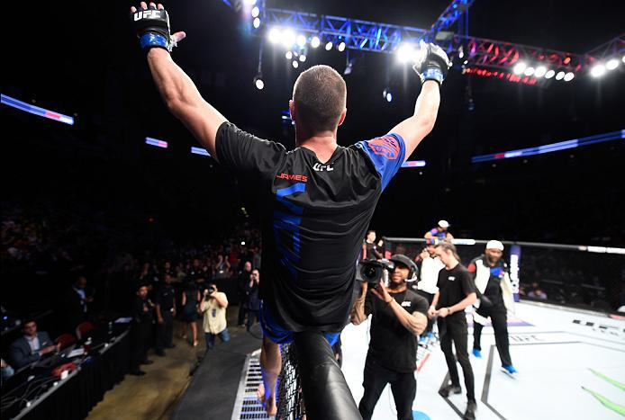 HOUSTON, TX - FEBRUARY 04:  James Vick celebrates his submission victory over Abel Trujillo in their lightweight bout during the UFC Fight Night event at the Toyota Center on February 4, 2017 in Houston, Texas. (Photo by Jeff Bottari/Zuffa LLC/Zuffa LLC v