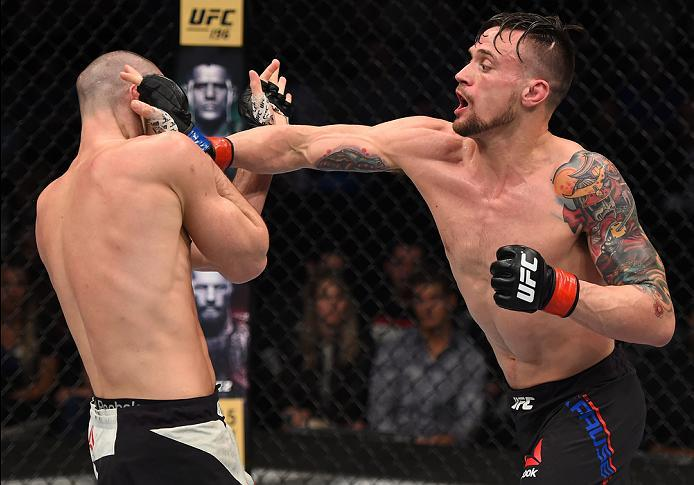 PITTSBURGH, PA - FEBRUARY 21:  (R-L) James Krause punches Shane Campbell in their lightweight bout during the UFC Fight Night event at Consol Energy Center on February 21, 2016 in Pittsburgh, Pennsylvania. (Photo by \2026405\/Zuffa LLC/Zuffa LLC via Getty