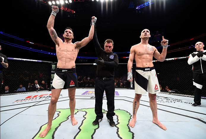PITTSBURGH, PA - FEBRUARY 21:  (L-R) James Krause celebrates his victory over Shane Campbell in their lightweight bout during the UFC Fight Night event at Consol Energy Center on February 21, 2016 in Pittsburgh, Pennsylvania. (Photo by \2026405\/Zuffa LLC