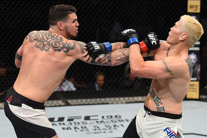 PITTSBURGH, PA - FEBRUARY 21:  (L-R) Chris Camozzi punches Joe Riggs in their middleweight bout during the UFC Fight Night event at Consol Energy Center on February 21, 2016 in Pittsburgh, Pennsylvania. (Photo by Jeff Bottari/Zuffa LLC/Zuffa LLC via Getty