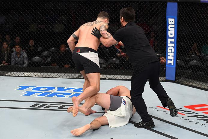 PITTSBURGH, PA - FEBRUARY 21:  (L-R) Chris Camozzi knocks out Joe Riggs in their middleweight bout during the UFC Fight Night event at Consol Energy Center on February 21, 2016 in Pittsburgh, Pennsylvania. (Photo by Jeff Bottari/Zuffa LLC/Zuffa LLC via Ge