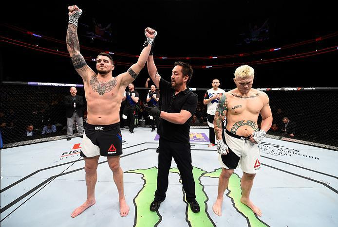 PITTSBURGH, PA - FEBRUARY 21:  (L-R) Chris Camozzi celebrates his victory over Joe Riggs in their middleweight bout during the UFC Fight Night event at Consol Energy Center on February 21, 2016 in Pittsburgh, Pennsylvania. (Photo by Jeff Bottari/Zuffa LLC