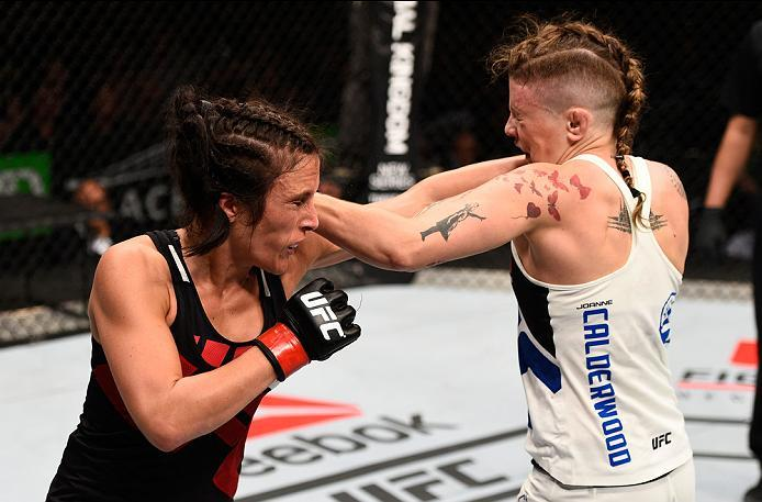 OTTAWA, ON - JUNE 18:   (L-R) Valerie Letourneau of Canada exchanges punches with Joanne Calderwood of Scotland in their women's flyweight bout during the UFC Fight Night event inside the TD Place Arena on June 18, 2016 in Ottawa, Ontario, Canada. (Photo