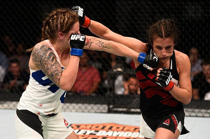 OTTAWA, ON - JUNE 18:   (L-R) Joanne Calderwood of Scotland punches Valerie Letourneau of Canada in their women's flyweight bout during the UFC Fight Night event inside the TD Place Arena on June 18, 2016 in Ottawa, Ontario, Canada. (Photo by Jeff Bottari