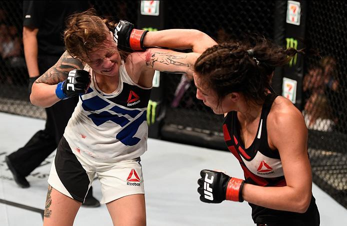 OTTAWA, ON - JUNE 18:   (R-L) Valerie Letourneau of Canada punches Joanne Calderwood of Scotland in their women's flyweight bout during the UFC Fight Night event inside the TD Place Arena on June 18, 2016 in Ottawa, Ontario, Canada. (Photo by Jeff Bottari