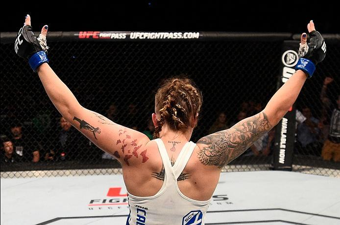 OTTAWA, ON - JUNE 18:   Joanne Calderwood of Scotland elbows Valerie Letourneau of Canada in their women's flyweight bout during the UFC Fight Night event inside the TD Place Arena on June 18, 2016 in Ottawa, Ontario, Canada. (Photo by Jeff Bottari/Zuffa