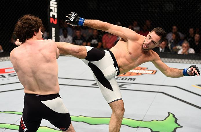 OTTAWA, ON - JUNE 18:   (R-L) Thibault Gouti of France kicks Olivier Aubin-Mercier of Canada in their lightweight bout during the UFC Fight Night event inside the TD Place Arena on June 18, 2016 in Ottawa, Ontario, Canada. (Photo by Jeff Bottari/Zuffa LLC