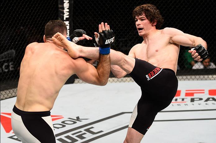 OTTAWA, ON - JUNE 18:   (R-L) Olivier Aubin-Mercier of Canada kicks Thibault Gouti of France in their lightweight bout during the UFC Fight Night event inside the TD Place Arena on June 18, 2016 in Ottawa, Ontario, Canada. (Photo by Jeff Bottari/Zuffa LLC