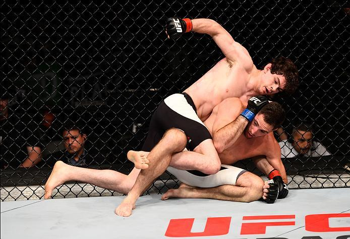 OTTAWA, ON - JUNE 18:   Olivier Aubin-Mercier of Canada (top) punches Thibault Gouti of France in their lightweight bout during the UFC Fight Night event inside the TD Place Arena on June 18, 2016 in Ottawa, Ontario, Canada. (Photo by Jeff Bottari/Zuffa L