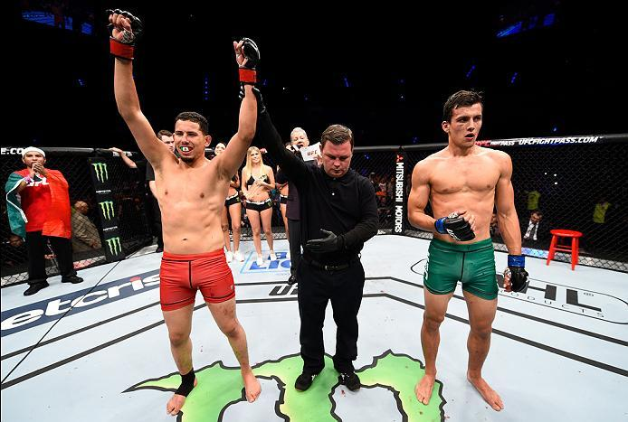 MEXICO CITY, MEXICO - NOVEMBER 05:  (L-R) Martin Bravo Flores of Mexico celebrates his victory over Claudio Puelles of Peru in their lightweight bout during the UFC Fight Night event at Arena Ciudad de Mexico on November 5, 2016 in Mexico City, Mexico. (P