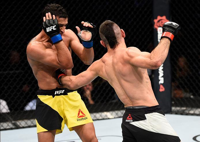 MEXICO CITY, MEXICO - NOVEMBER 05:  (R-L) Ricardo Lamas of the United States punches Charles Oliveira of Brazil in their featherweight bout during the UFC Fight Night event at Arena Ciudad de Mexico on November 5, 2016 in Mexico City, Mexico. (Photo by Je