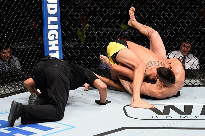 MEXICO CITY, MEXICO - NOVEMBER 05:  (R-L) Ricardo Lamas of the United States submits Charles Oliveira of Brazil in their featherweight bout during the UFC Fight Night event at Arena Ciudad de Mexico on November 5, 2016 in Mexico City, Mexico. (Photo by Je